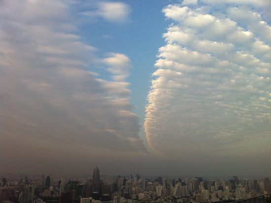 Sky above Vertigo Bangkok before sunset. An incredible cloud formation, like the sky's being opened up